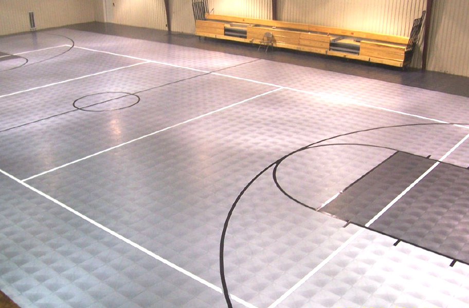 Basketball court plastic flooring all courts sport tiles for Indoor sport court cost